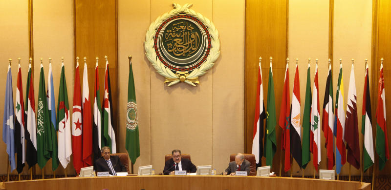 Arab League Secretary General Amr Moussa, left, and Iraqi Foreign Minister Hoshyar Zebari, center, head an Arab League foreign ministers meeting at the Arab League headquarters in Cairo, Egypt Wednesday, March 2, 2011. Others are unidentified. (AP Photo/Nasser Nasser)