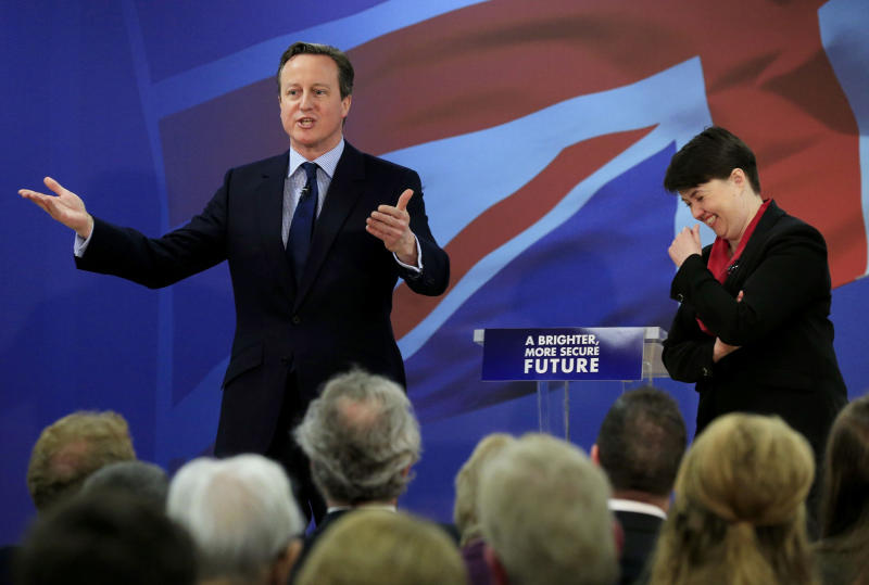 File photo dated 16/04/15 of Prime Minister David Cameron and Leader of the Scottish Conservative and Unionist Party Ruth Davidson respond to questions from media at the launch of the Scottish Conservatives' election manifesto at the Emirates Arena, Glasgow. Ms Davidson has confirmed she is stepping down as leader of the Scottish Conservatives.