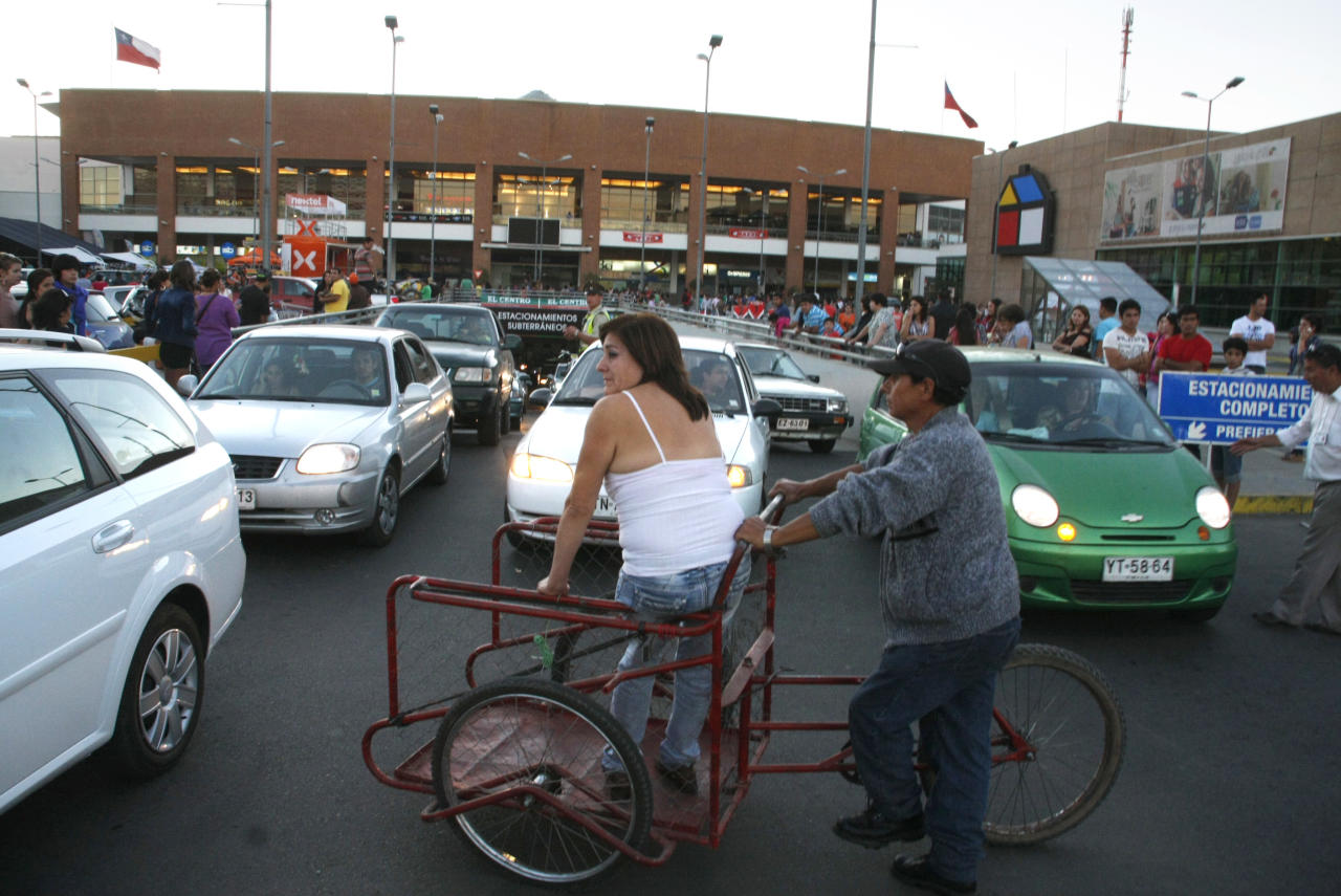 People gather outside a shopping mall after an earthquake was felt in Talca, Chile, Sunday, March 25, 2012. A magnitude-7.2 earthquake has struck just off the coast of central Chile, prompting an emergency evacuation order for people living near the ocean in case it spawns a tsunami. (AP Photo/Fabian Suazo)