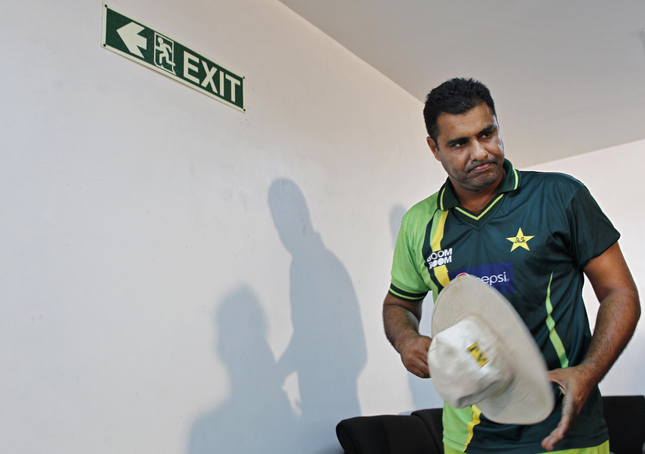 Pakistan's cricket coach Waqar Younis leaves a news conference prior to a practice session in Hambantota, Sri Lanka, Monday, Feb. 21, 2011. Pakistan will face Kenya in a Cricket World Cup match on Wednesday.