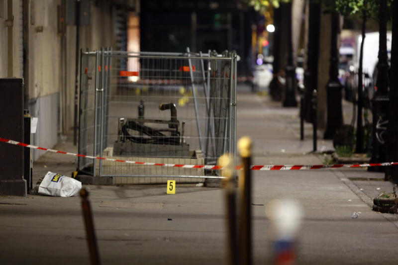 An evidence is seen at the site of a knife attack in Paris, Monday, Sept. 10, 2018. A several people were injured in a knife attack in central Paris late Sunday but police said that terrorism was not suspected. (AP Photo/Thibault Camus)