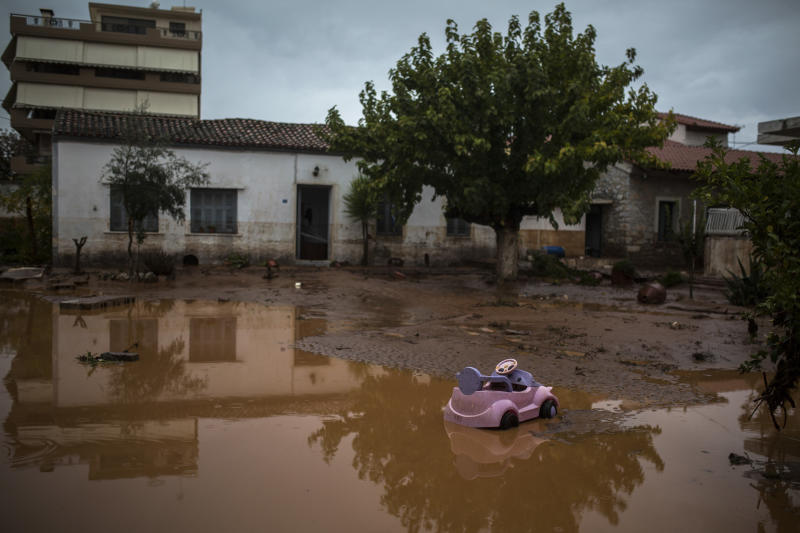 A toy car is seen in a flooded street next to a damaged house in the town of Mandra. (Angelos Tzortzinis/AFP/Getty Images)