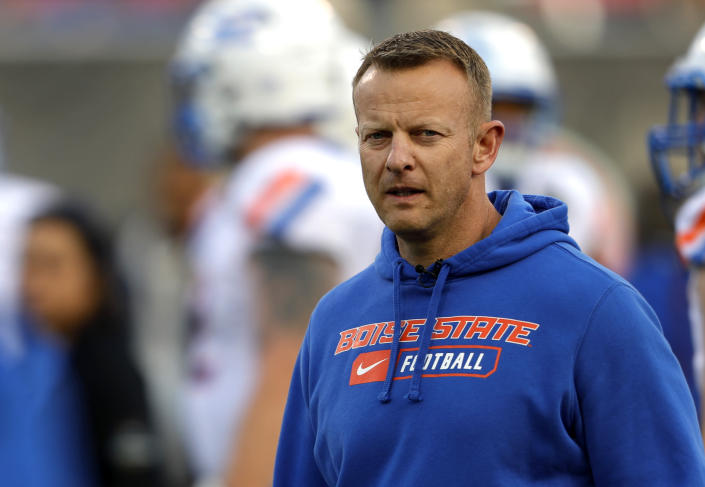 FILE - In this Saturday, Dec. 21, 2019 file photo, Boise State coach Bryan Harsin watches his players warm up for the Las Vegas Bowl NCAA college football game against Washington at Sam Boyd Stadium in Las Vegas. No. 25 San Jose State will face perennial conference powerhouse Boise State in the Mountain West championship on Saturday, Dec. 19, 2020 in Las Vegas. The game is usually played on the higher seed's home field but this year it will be held at Sam Boyd Stadium. (AP Photo/Steve Marcus, File)