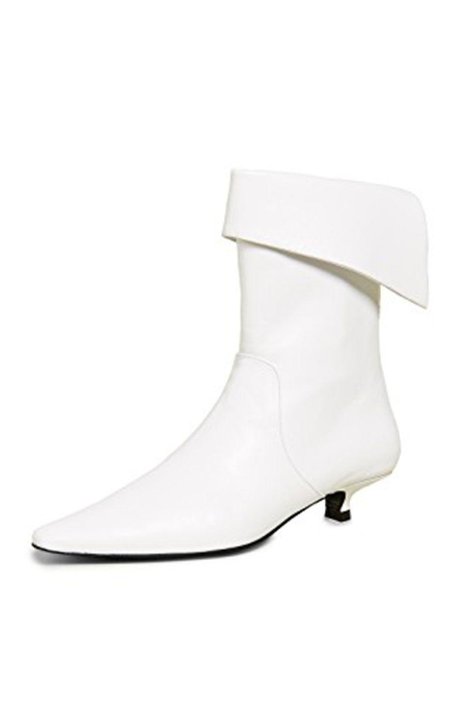 """<p><a class=""""link rapid-noclick-resp"""" href=""""https://go.redirectingat.com?id=127X1599956&url=https%3A%2F%2Fwww.shopbop.com%2Fcrucified-ankle-boot-dorateymur%2Fvp%2Fv%3D1%2F1508818951.htm%3Ffm%3Dsearch-viewall-shopbysize%26os%3Dfalse&sref=https%3A%2F%2Fwww.harpersbazaar.com%2Fuk%2Ffashion%2Fshows-trends%2Fg18195015%2Fbest-white-boots%2F"""" rel=""""nofollow noopener"""" target=""""_blank"""" data-ylk=""""slk:SHOP NOW"""">SHOP NOW</a></p><p>A lower heel has proven particularly popular with the street style set.</p><p>Leather boots, £538.35, Dorateymur at Shopbop</p>"""