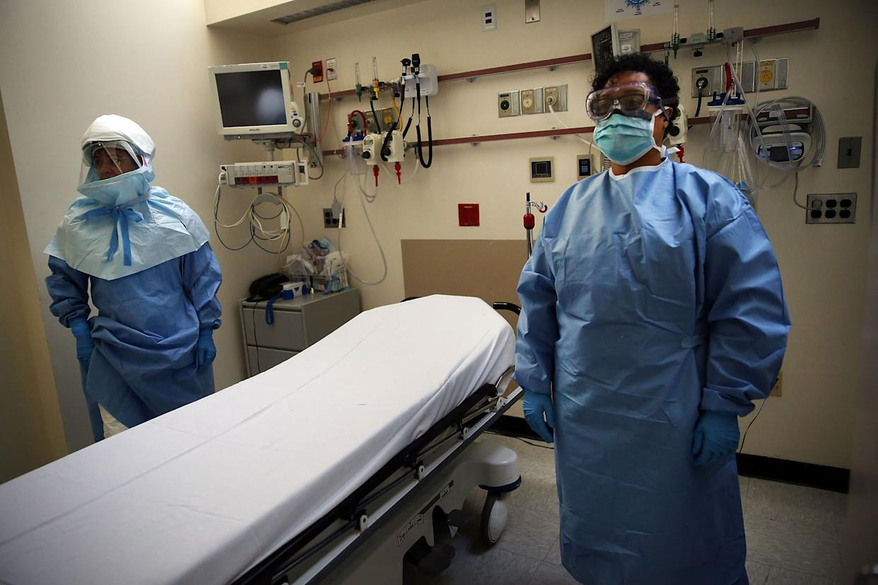 Members of Bellevue Hospital staff wear protective clothing as they demonstrate how they would receive a suspected Ebola patient on October 8, 2014 in New York City.