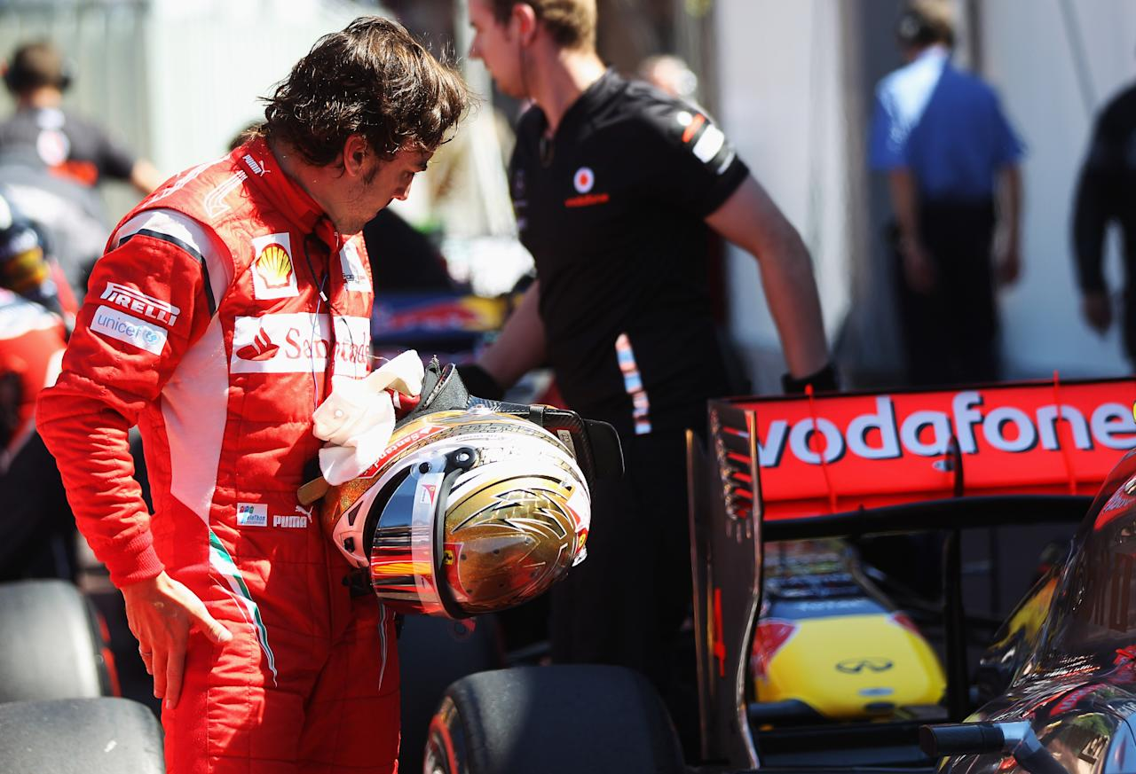 MONTE CARLO, MONACO - MAY 28:  Fernando Alonso of Spain and Ferrari reacts following qualifying for the Monaco Formula One Grand Prix at the Monte Carlo Circuit on May 28, 2011 in Monte Carlo, Monaco.  (Photo by Mark Thompson/Getty Images)