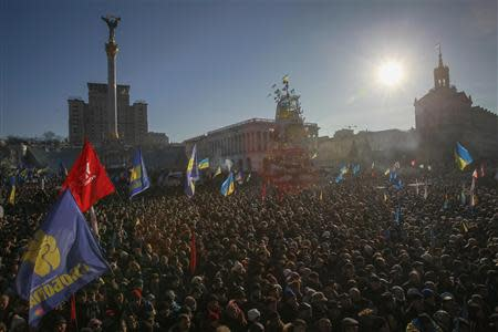 Pro-European integration protesters wave flags during a rally in Independence square in Kiev December 22, 2013. REUTERS/Gleb Garanich