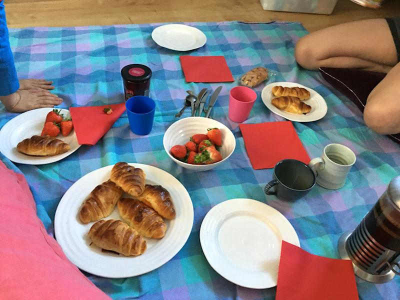 One day of their 'trip', they woke up to a French breakfast (SWNS)