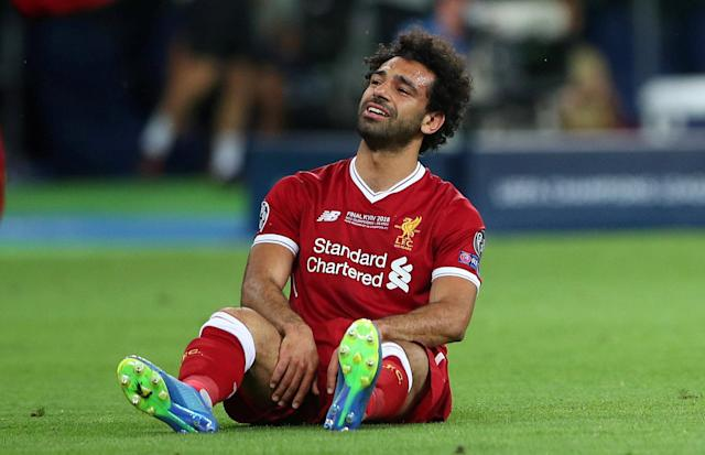 Soccer Football - Champions League Final - Real Madrid v Liverpool - NSC Olympic Stadium, Kiev, Ukraine - May 26, 2018 Liverpool's Mohamed Salah looks dejected after sustaining an injury REUTERS/Hannah McKay TPX IMAGES OF THE DAY