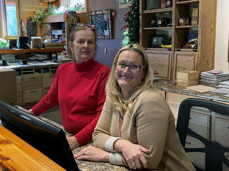 Janet Hedrick and her daughter Janel Henritz pose for a picture in Cabins