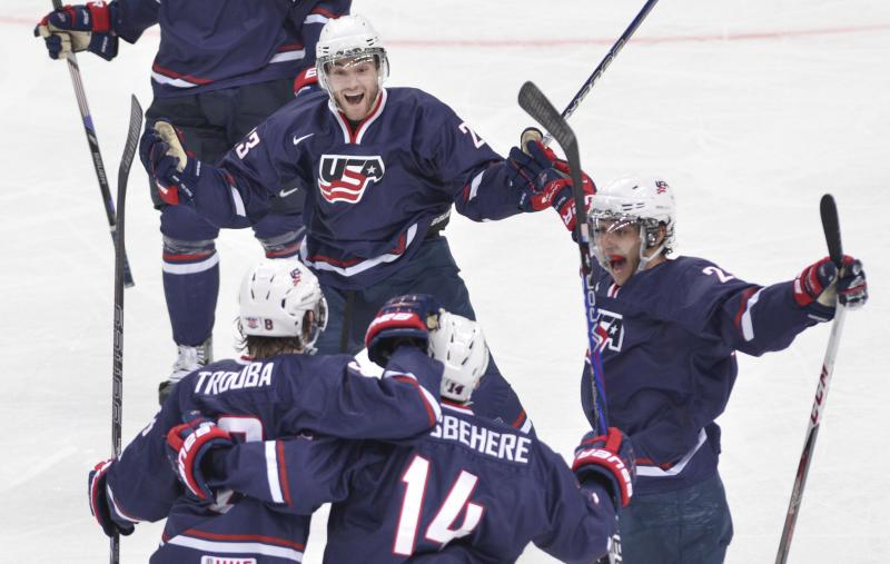 Team USA's Rocco Grimaldi, top celebrates his second goal against Sweden with teammates, from left, Jacob Trouba, Shayne Gostisbehere and Vince Trocheck during second period gold medal hockey action at the IIHF World Junior Championships in Ufa, Russia, on Saturday, Jan. 5, 2013. (AP Photo/The Canadian Press, Nathan Denette)
