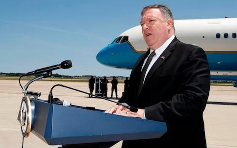 Mike Pompeo departed for the hastily organised trip from Andrews Air Force Base - Credit: JACQUELYN MARTIN/AFP/Getty Images