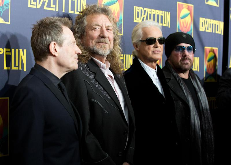 "FILE - This Oct. 9, 2012 file photo shows musicians, from left, John Paul Jones, Robert Plant, Jimmy Page and Jason Bonham at the""'Led Zeppelin: Celebration Day"" premiere in New York. CBS' ""60 Minutes"" webcast reported Monday, May 6, 2013, that former President Clinton was enlisted to ask the British rock band to get back together last year for the Superstorm Sandy benefit concert in New York. He asked, they said no. David Saltzman of the Robin Hood Foundation says he and film executive Harvey Weinstein flew to Washington to ask Clinton to make the plea. Led Zeppelin's surviving members Robert Plant, John Paul Jones and Jimmy Page were in Washington just before the Sandy concert for the Kennedy Center Honors. Led Zeppelin last played publicly at a one-night reunion in London in 2007.  (Photo by Dario Cantatore/Invision/AP, file)"