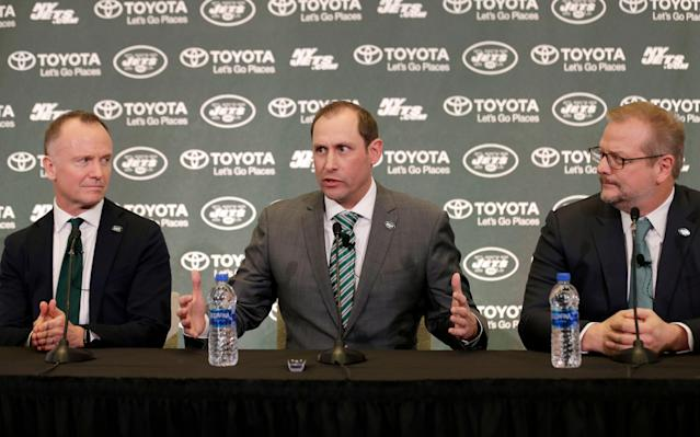 Jets CEO Christopher Johnson (L), pictured with head coach Adam Gase (M) and former GM Mike Maccagnan, had little explanation for the timing of Maccagnan's firing. (AP)