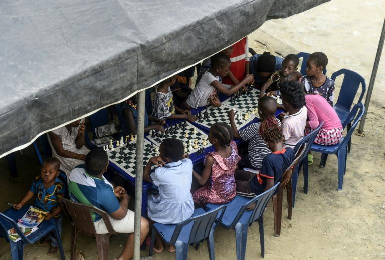 Chess -- a board game famous for its reliance on strategy -- has a tiny but avid following in Nigeria where Scrabble is much more popular (AFP Photo/PIUS UTOMI EKPEI)