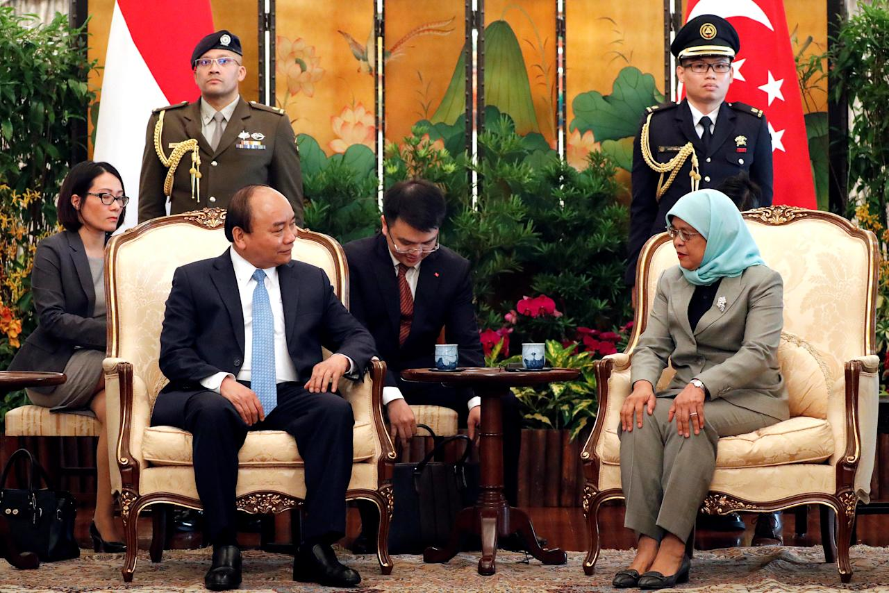 Vietnam's Prime Minister Nguyen Xuan Phuc, left, sits with Singapore's President Halimah Yacob during their meeting at the Istana or presidential palace in Singapore April 25, 2018. Wong Maye-E/Pool via REUTERS