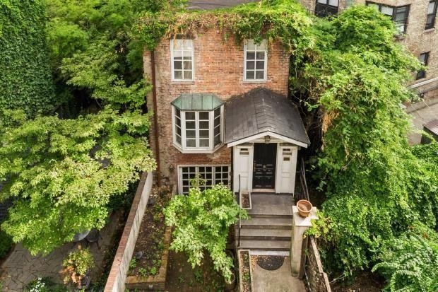"""<p>On the market for £3.9 million, this New York property has five bedrooms, five bathrooms, a garden, a wood-burning fireplace and a private roof deck with stellar city views. </p><p><a href=""""https://www.rightmove.co.uk/properties/76299157"""" rel=""""nofollow noopener"""" target=""""_blank"""" data-ylk=""""slk:This property is currently on the market for £3,964,070 with Savills Global via Rightmove"""" class=""""link rapid-noclick-resp"""">This property is currently on the market for £3,964,070 with Savills Global via Rightmove</a>. </p>"""