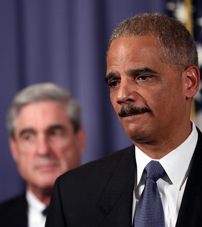 Attorney General Eric Holder, right, accompanied by FBI Director Robert Mueller, gestures during a news conference at the Justice Department in Washington, Tuesday, Oct. 11, 2011. Holder announced that two individuals have been charged in New York for their alleged participation in a plot directed by elements of the Iranian government to murder the Saudi Ambassador to the United States with explosives while the ambassador was in the United States. (AP Photo/Haraz N. Ghanbari)