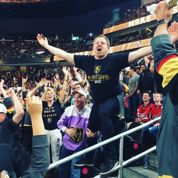 Professional superfan Cameron Hughes typically spends the sports seasons dancing in the aisles of packed arenas and hyping the crowd.  (Submitted by Cameron Hughes - image credit)