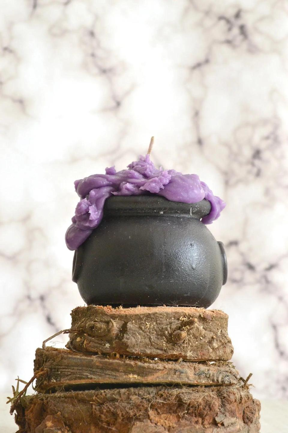 """<p>This <span>Witches Cauldron Candle</span> ($10) pairs nicely with <a class=""""link rapid-noclick-resp"""" href=""""https://www.popsugar.com/Halloween"""" rel=""""nofollow noopener"""" target=""""_blank"""" data-ylk=""""slk:Halloween"""">Halloween</a> witch decor. Watch as the Berry Bewitching Brew begins to bubble once lit to a flame. </p>"""
