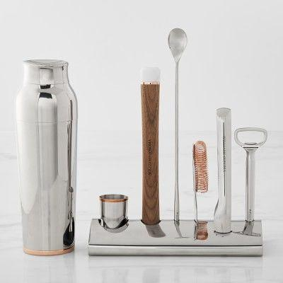 """<p>williams-sonoma.com</p><p><strong>$199.95</strong></p><p><a href=""""https://go.redirectingat.com?id=74968X1596630&url=https%3A%2F%2Fwww.williams-sonoma.com%2Fproducts%2Fws-bar-tool-set-with-stand-cocktail-shaker&sref=https%3A%2F%2Fwww.delish.com%2Fkitchen-tools%2Fg33936411%2Fbest-bartending-kits%2F"""" rel=""""nofollow noopener"""" target=""""_blank"""" data-ylk=""""slk:BUY NOW"""" class=""""link rapid-noclick-resp"""">BUY NOW</a></p><p>Splurging on something nice for yourself could definitely include a bartending kit and this luxurious choice should be on your list. Not only do you get a three-part shaker, strainer, bar spoon, jigger, bottle opener, muddler, and ice tongs, but you also get a trendy stand that holds them all. <em>Fancy</em>.</p>"""