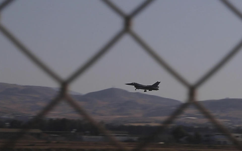 In this image taken from video, a Greek Air Force F-16 aircraft lands at Cyprus' Andreas Papandreou Air Base near southwestern coastal city of Paphos, Cyprus, Tuesday, Aug. 25, 2020. Cyprus' Defense Ministry says warplanes and navy ships from France, Italy, Greece and Cyprus are taking part in a three-day air and sea military exercise off the east Mediterranean island nation. (AP Photo/Petros Karadjias)