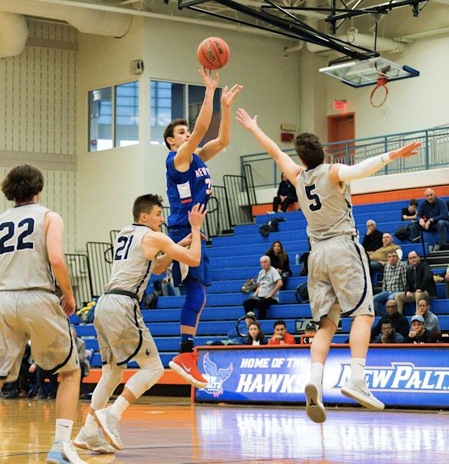 Nick Paquette rises up to shoot a jumper in a game earlier this season. (Reid Dalland Photography)