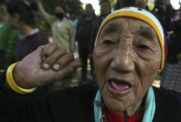 A Tibetan exile shouts slogans during a protest in New Delhi February 18, 2012.