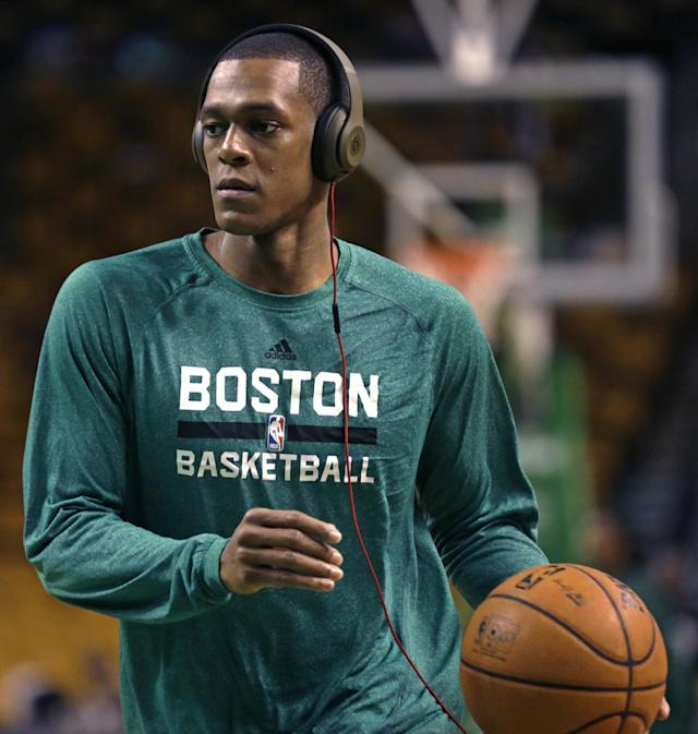 """Boston Celtics guard Rajon Rondo wears headphones as he works out during a practice before an NBA basketball game against the Los Angeles Lakers, in Boston, Friday, Jan. 17, 2014. Celtics head coach Brad Stevens and general manager Danny Ainge both said Rondo would return for the game """"barring any setbacks."""" (AP Photo/Charles Krupa)"""