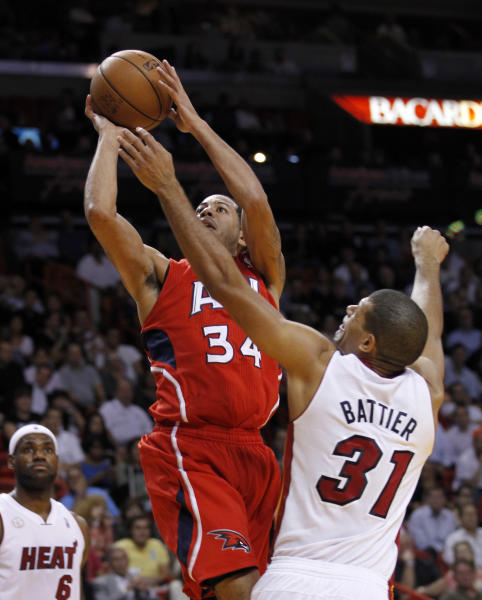 Atlanta Hawks' Devin Harris (34) prepares to shoot as Miami Heat's Shane Battier (31) defends in the first half of an NBA basketball game, Monday, Dec, 10, 2012, in Miami. (AP Photo/Alan Diaz)