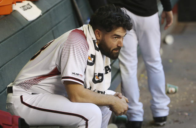 Arizona Diamondbacks starting pitcher Robbie Ray sits in the dugout after giving up two runs to the Pittsburgh Pirates during the first inning of a baseball game Monday, May 13, 2019, in Phoenix. (AP Photo/Ross D. Franklin)