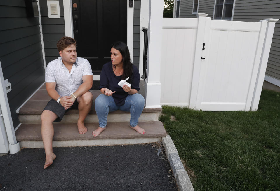 """Barth and Rosa Bazyluk talk about their time living at the Austin Nichols house, a rent-stabilized apartment building in Brooklyn, while sitting outside their home July 5, 2018, in West Harrison, N.Y. Despite seven years in the apartment, the Bazyluks moved to West Harrison after the building was bought by the Kushner Cos. An Associated Press investigation into one of the Kushner Cos.' largest residential buildings in New York City reveals what some residents say was a campaign that used noisy construction to push rent-stabilized tenants out and bring high-paying condo buyers in. More than a dozen tenants told the AP that they were subjected to relentless banging, drilling, dust and rats. """"They won, they succeeded,"""" says Barth Bazyluk, who left apartment C606 with his wife and baby daughter in December. """"You have to be ignorant or dumb to think this wasn't deliberate.""""  (AP Photo/Julie Jacobson)"""