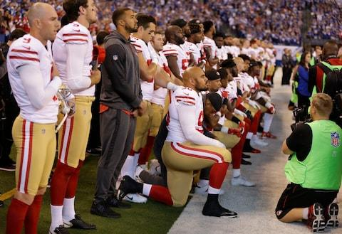 Members of the San Francisco 49ers kneel during the playing of the national anthem before an NFL football game against the Indianapolis Colts, Sunday, Oct. 8, 2017 - Credit: Michael Conroy/AP