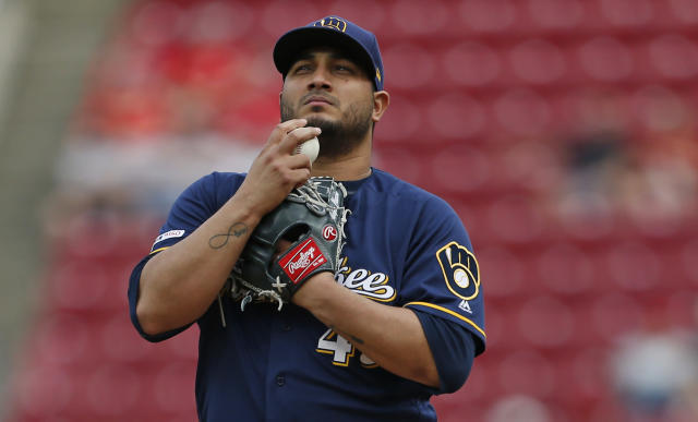 Milwaukee Brewers starting pitcher Jhoulys Chacin (45) prepares himself before throwing his first pitch during the first inning of a baseball game the Cincinnati Reds, Wednesday, July 3, 2019, in Cincinnati. (AP Photo/Gary Landers)