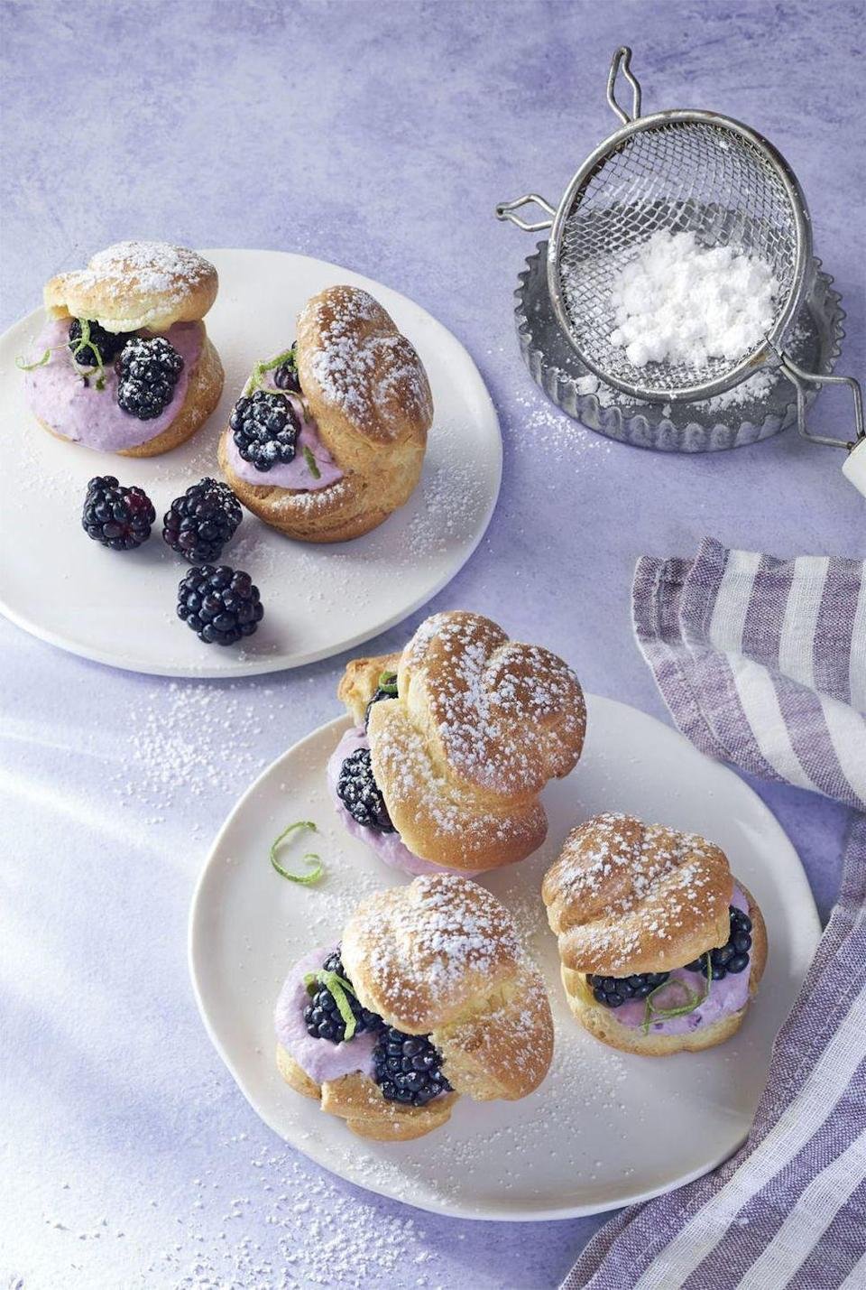"""<p>Use store-bought profiterole shells to keep this dessert quick n' easy (and no sweat!).</p><p><em><a href=""""https://www.countryliving.com/food-drinks/recipes/a41985/blackberry-lime-cream-puffs-recipe/"""" rel=""""nofollow noopener"""" target=""""_blank"""" data-ylk=""""slk:Get the recipe from Country Living »"""" class=""""link rapid-noclick-resp"""">Get the recipe from Country Living »</a></em></p>"""
