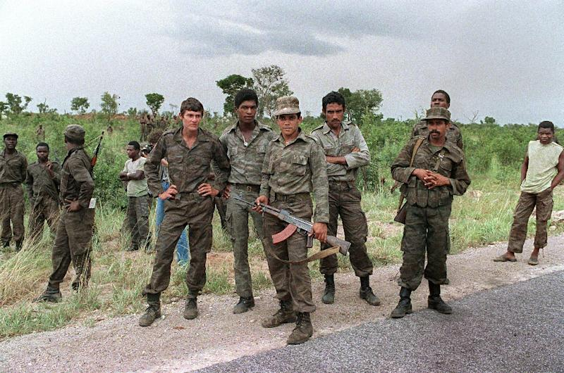 Cuban soldiers helping the Angolan regular army and Soviet-backed Marxist MPLA regime patrol near Cuito Cuanavale, southern Angola, on February 29, 1988 where they were fighting the Western-backed UNITA nationalist movement