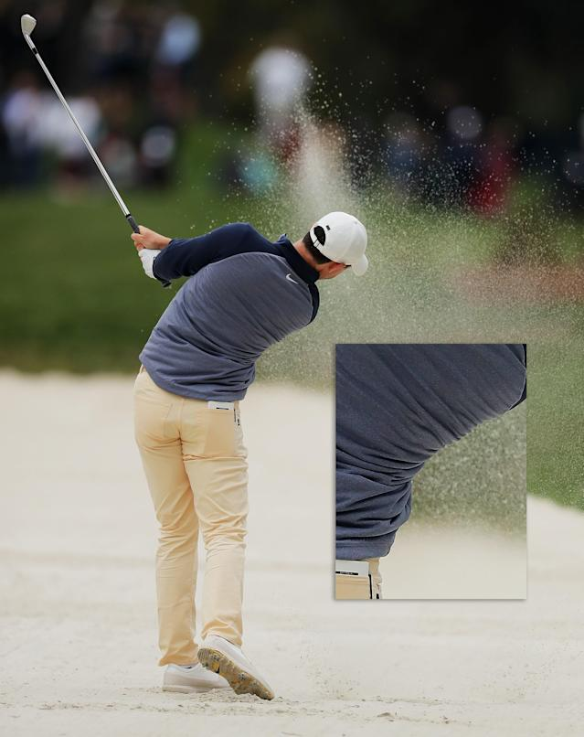 "Many players try to change their technique to get it out of a fairway bunker because they think they need to stay still and ""pick"" the ball the clean. In reality, you should stay with your regular swing, like Rory McIlroy does. The precision clean contact on any shot requires comes from using your normal body turn and swing shape. Look how Rory has rotated his shoulders and hips and moved the club around his body."