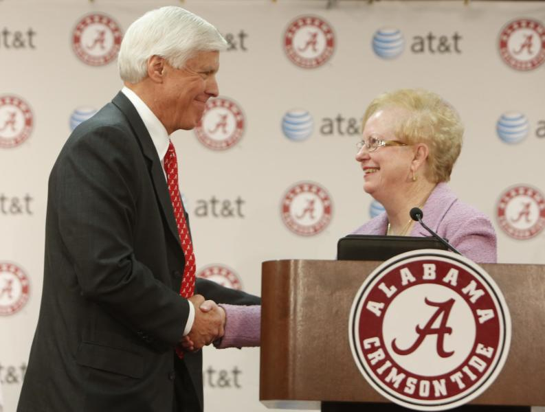 University of Alabama President Judy Bonner introduces Bill Battle as the schools new athletic director during a news conferenceat the University of Alabama Friday March 22, 2013 in Tuscaloosa, Ala. (AP Photo/The Tuscaloosa News, Robert Sutton)