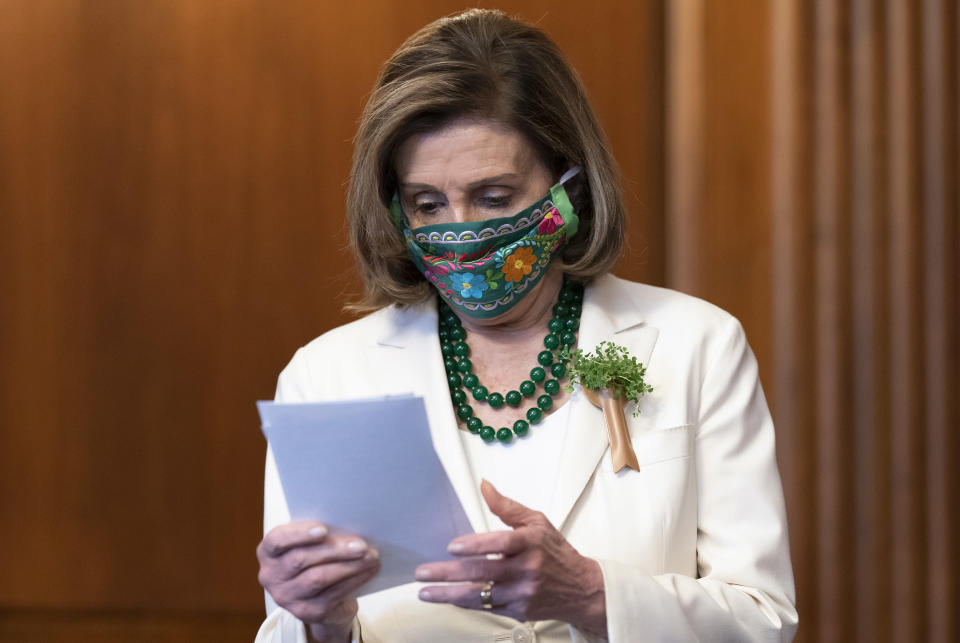 Speaker of the House Nancy Pelosi, D-Calif., looks over her notes at a news conference on reauthorizing the Violence Against Women Reauthorization Act, at the Capitol in Washington, Wednesday, March 17, 2021. (AP Photo/J. Scott Applewhite)