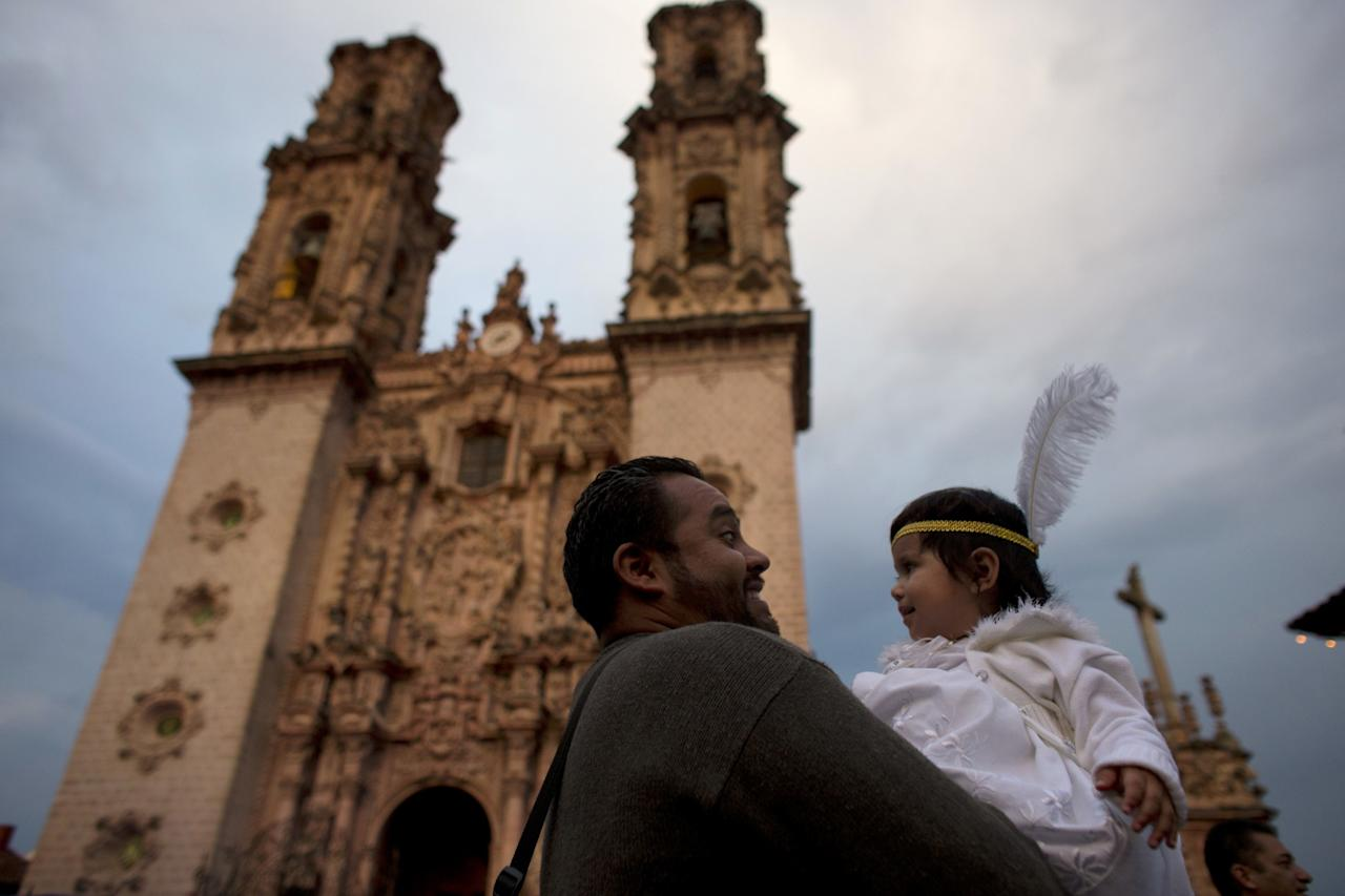 <p>Mexico: Hugo Contreras carries his 15-month-old daughter Gabriela, dressed as an angel, as they wait for the start of a Holy Week procession outside the Santa Prisca Church in Taxco, Guerrero state, Mexico, Thursday, April 13, 2017. Holy Week commemorates the last week of the earthly life of Jesus Christ, culminating in his crucifixion on Good Friday and his resurrection on Easter Sunday. (AP Photo/Rebecca Blackwell) </p>