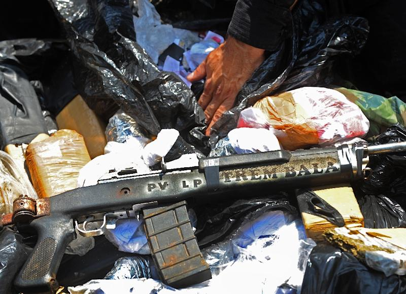 A study of 14,000 weapons confiscated between 2013 and 2014 showed that 86 percent had been made in Brazil (AFP Photo/Antonio Scorza)