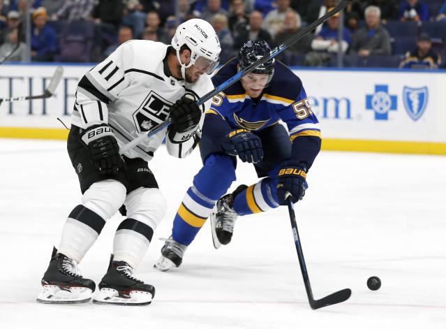 Los Angeles Kings' Anze Kopitar (11), of Slovenia, and St. Louis Blues' Colton Parayko chase after a loose puck during the first period of an NHL hockey game Monday, Nov. 19, 2018, in St. Louis. (AP Photo/Jeff Roberson)