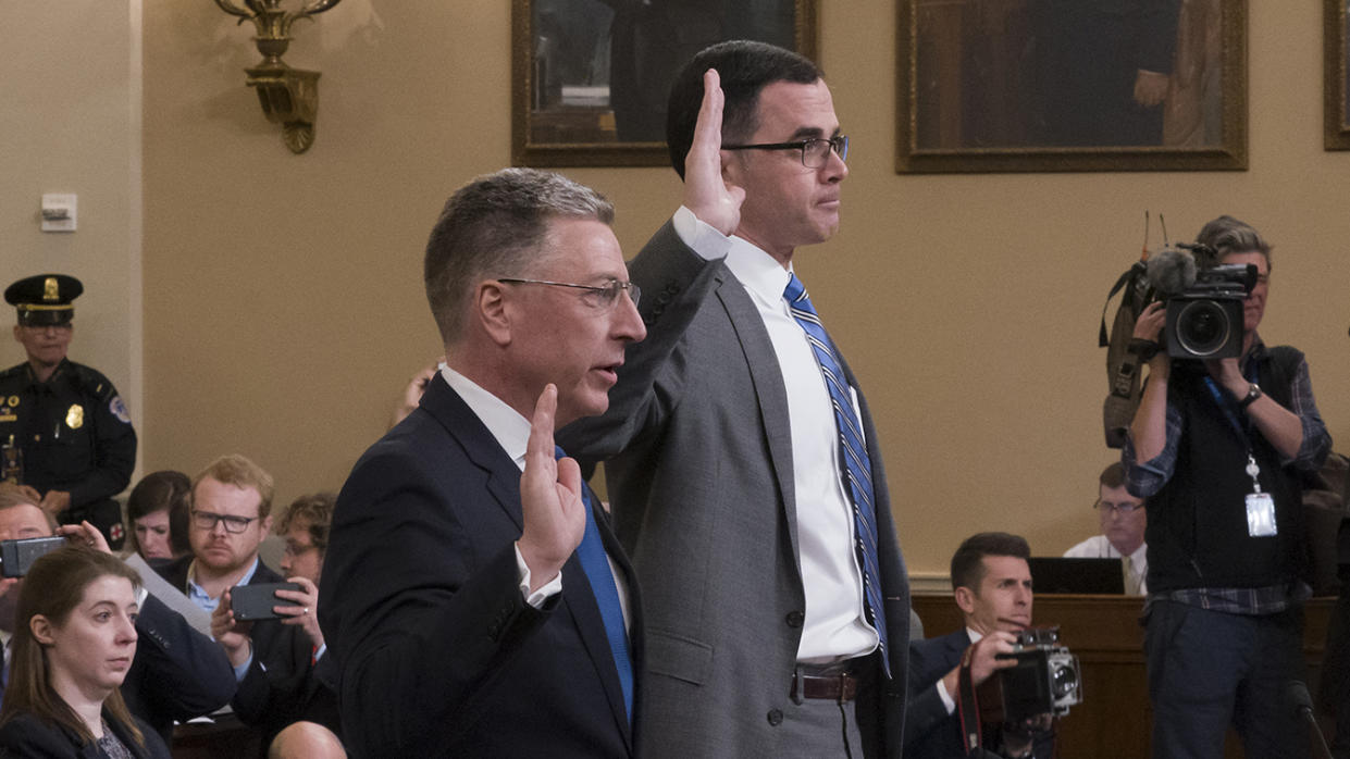 Ambassador Kurt Volker, left, former special envoy to Ukraine, and Tim Morrison, a former official at the National Security Council, are sworn in to testify before the House Intelligence Committee on Capitol Hill in Washington, Tuesday, Nov. 19, 2019, during a public impeachment hearing of President Donald Trump's efforts to tie U.S. aid for Ukraine to investigations of his political opponents. (Photo: J. Scott Applewhite/AP)