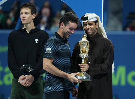 Tennis - ATP - Qatar Open - Khalifa International Tennis and Squash Complex, Doha, Qatar - January 5, 2019 Spain's Roberto Bautista Agut celebrates with the trophy after winning the final against Czech Republic's Tomas Berdych REUTERS/Ibraheem Al Omari