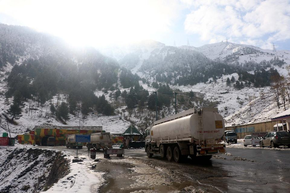 Vehicles crossing tunnel after highway was blocked by snowfall in Jawahir Tunnel.