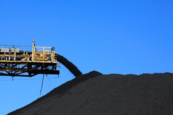 Coal being piled up from a giant conveyor.