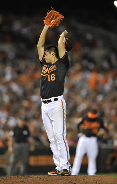 Baltimore Orioles pitcher Wei-Yin Chen wipes his face in the fourth inning of a baseball game against the New York Yankees Friday, Sept. 7, 2012, in Baltimore. Chen gave up five runs in the inning, including two home runs. (AP Photo/Gail Burton)