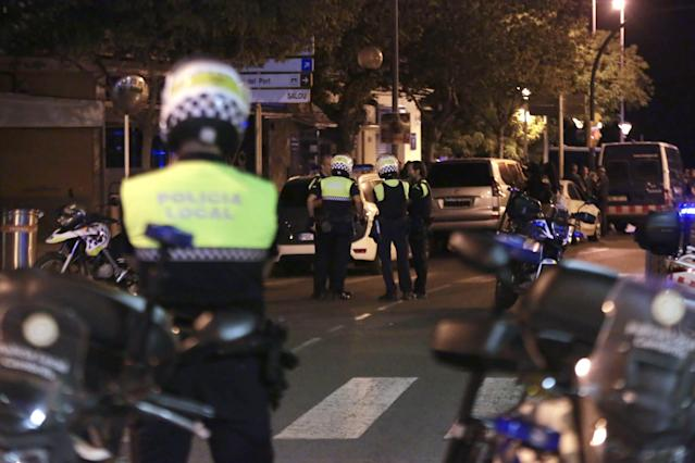 <p>Spanish Policemen inspect a street in Cambrils (Tarragona), northeastern Spain, Aug. 18, 2017, where at least four suspected terrorists have been killed by the police after they knocked down six people with their car at Paseo Maritimo. (Photo: David Gonzalez/EPA/REX/Shutterstock) </p>