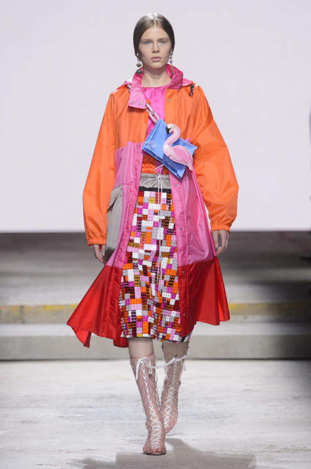 <p><i>Model wears a bright orange, pink, and red raincoat. (Photo: ImaxTree) </i></p>