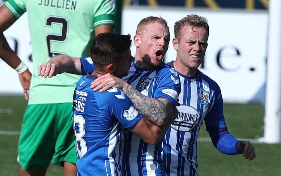 Chris Burke of Kilmarnock celebrates with his team-mates as they snatch a draw against Celtic - GETTY IMAGES